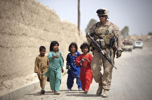 Children Following Marine On Patrol