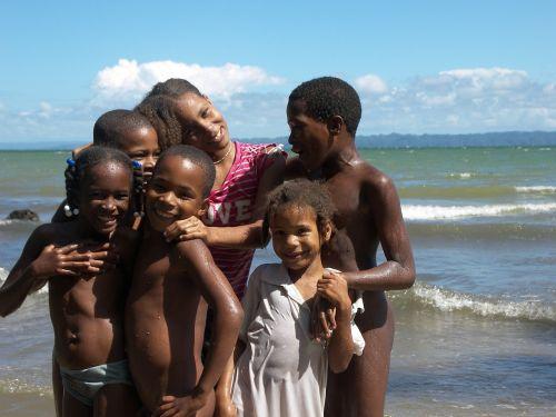 children laughing beach ethnic