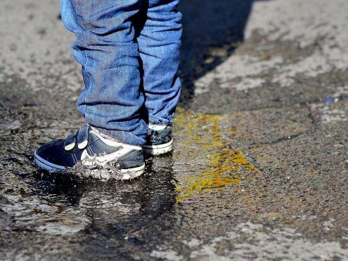 children's feet puddle splash