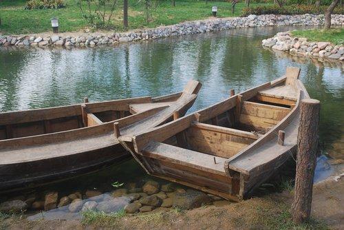 chinese  rowboats  pond