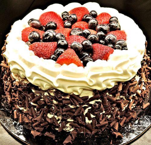 chocolate layer cake chocolate shavings strawberries