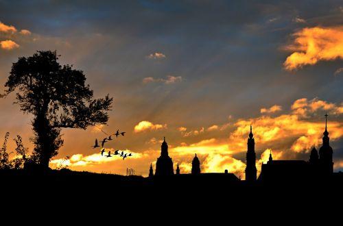 city view evening sky silhouette