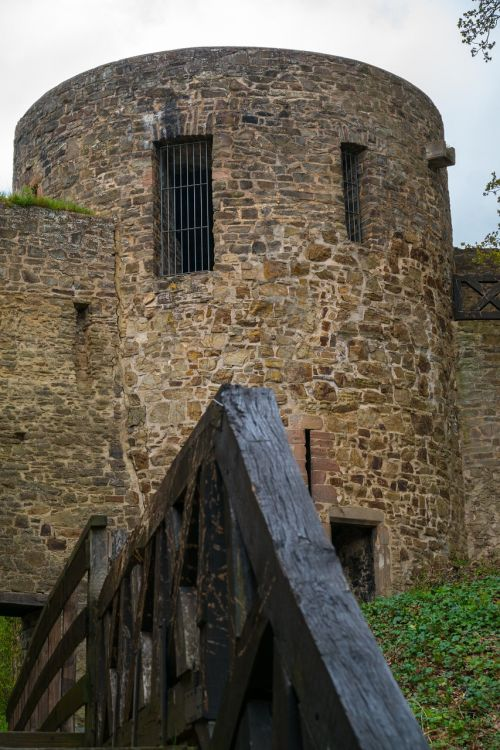 city wall,tower,johannistor,bad münstereifel,historically,natural stone,defensive tower,germany,fortress,old,middle ages,knight,castle,defense,protection,wall,stone,stone wall,railing,wood railings,free photos,free images,royalty free