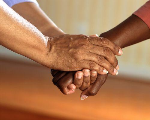 clasped hands comfort hands