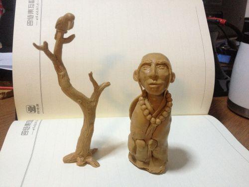 clay sculpture tree buddhist monk