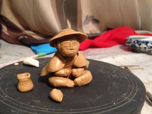 clay sculpture fisher clay figurine