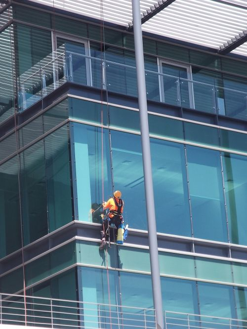 cleaning window building