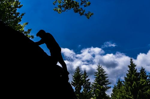 climb silhouette rock