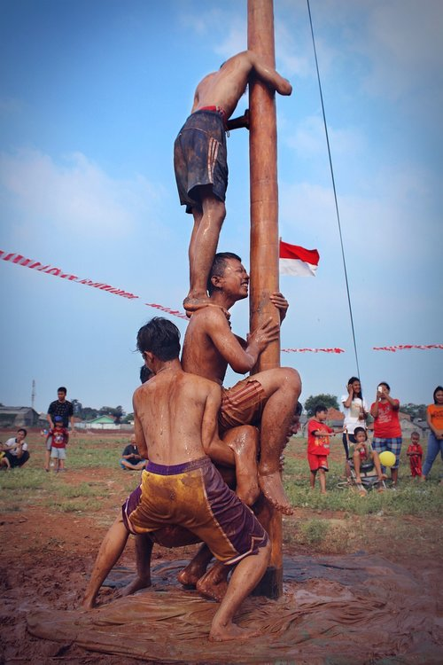 climbing slippery pole  the annual event  independence