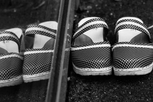 clogs footwear window reflection