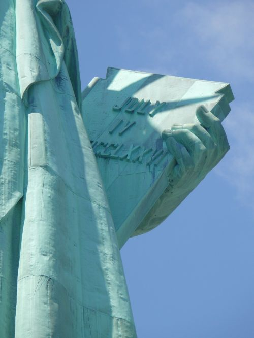 close up image of lady liberty lady liberty close up book inscription
