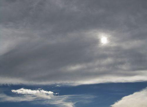 Cloud Bank With Sun Penetrating