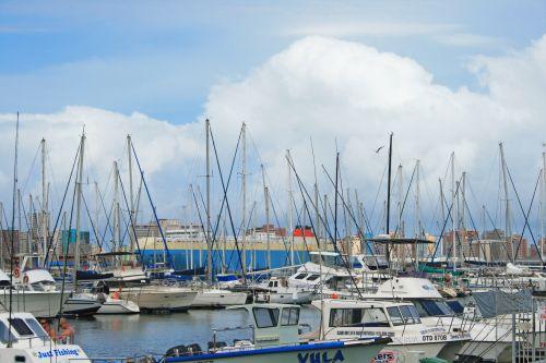 Cloud Behind Masts Of Yachts
