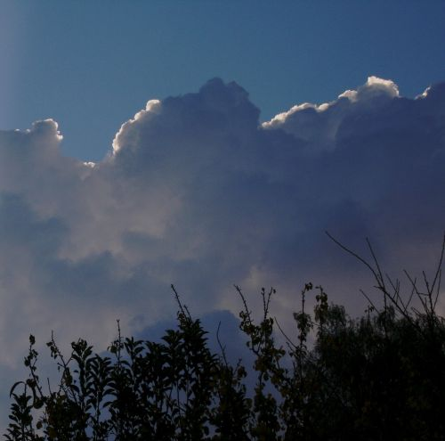 clouds massed puffy