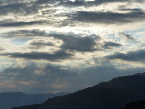 clouds sunbeam sun