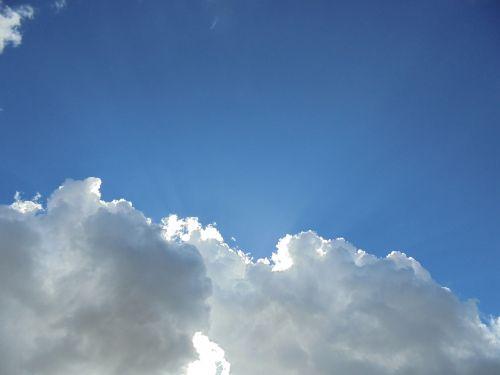 clouds sunbeams nature