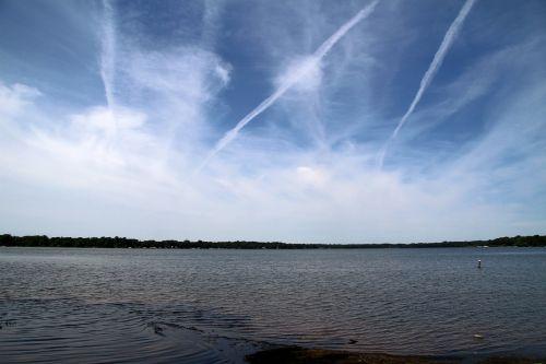 clouds lake contrails