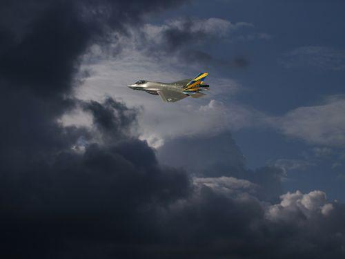 clouds dramatic clouds fighter jet