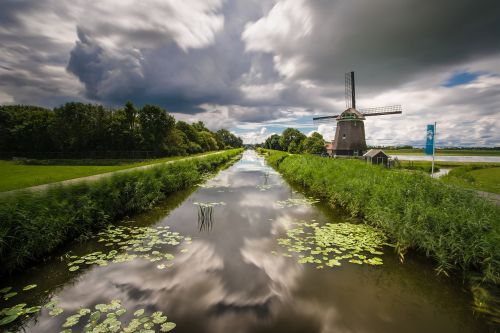 clouds water windmill