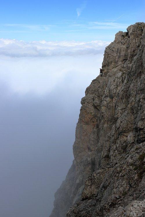 clouds  rock  climber
