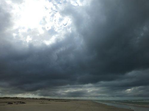 clouds gloomy beach