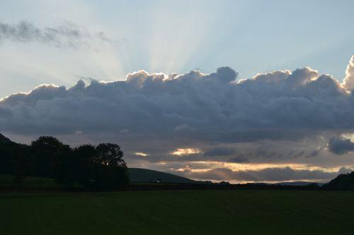 clouds sunrays sunbeam