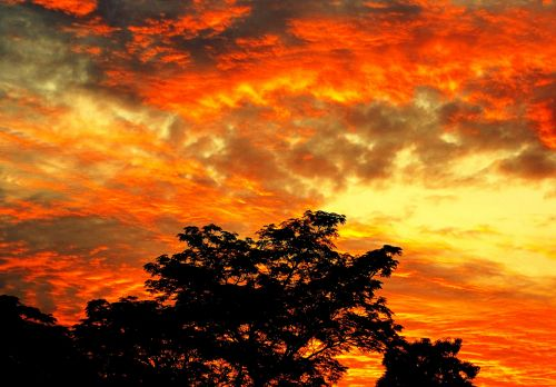 Clouds And Fiery Sunset
