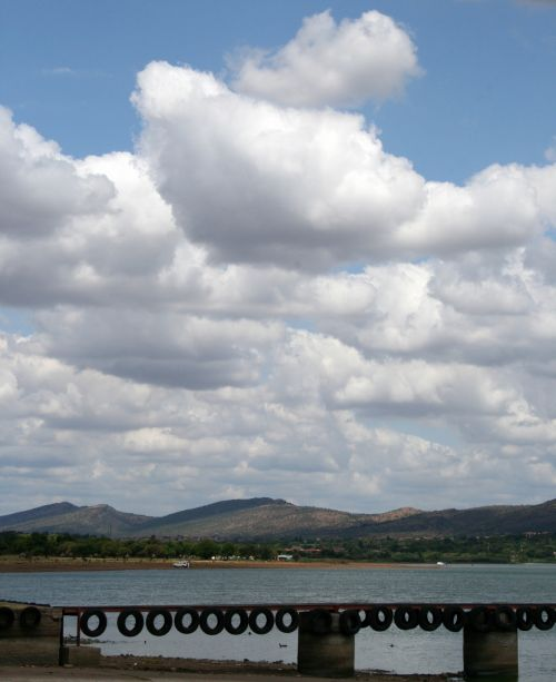Clouds Over Jetty And Dam