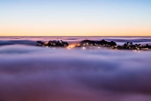 cloudscape above housing