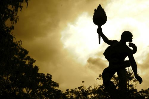 cloudy statue torch