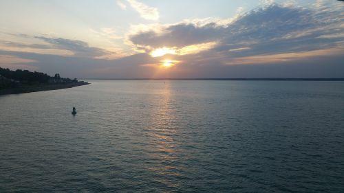 debesuota saulėlydis,vandenynų saulėlydis,saulėlydis per jūrą