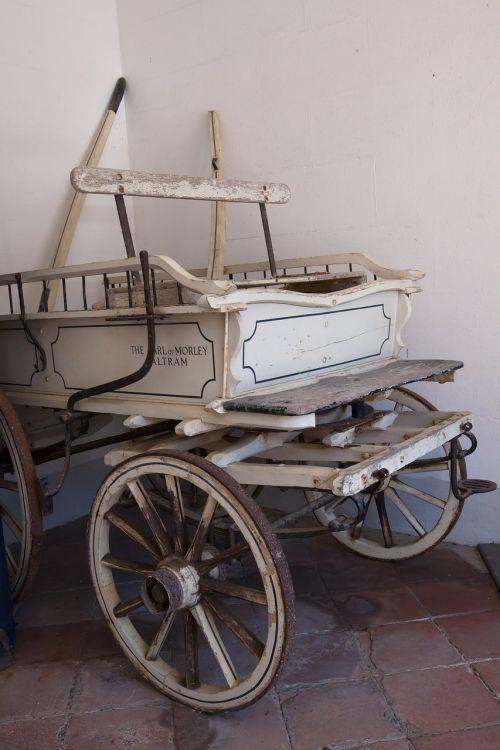 coach white wooden wheels