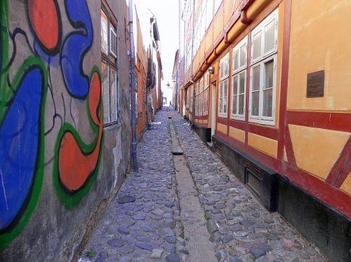 cobblestone street narrow street graffiti
