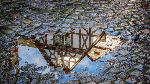 cobblestones  rain  mirroring