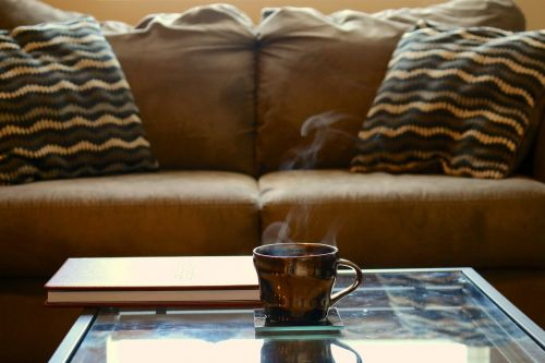 coffee,coffee table,couch,leather book,glass table,cup,cup of coffee,coffee cup,drink,home,mug,morning,brown,table,hot,beverage,breakfast