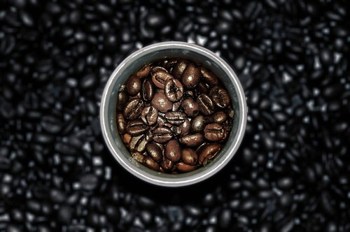 coffee cup  coffee beans  wooden table