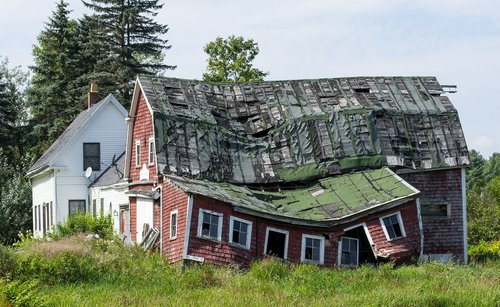 collapsed house  uninhabitable house  crooked roof
