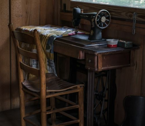 colonial,sewing,old,antique,sewing-machine,ft christmas,florida,village,cabin,morning,chair,historical