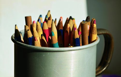 colored pencils pens container
