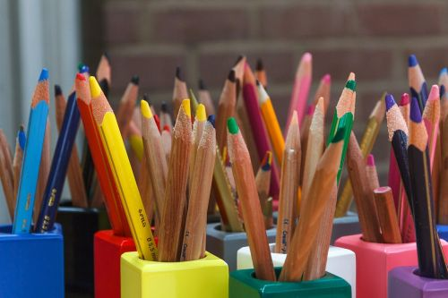 colored pencils color wooden pegs
