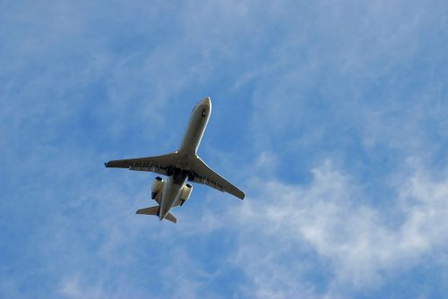 commercial jet aircraft flying