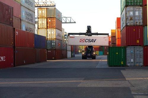 container  loading crane  sunrise