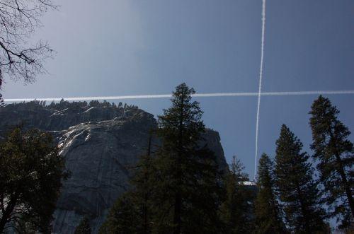 contrails sky mountain