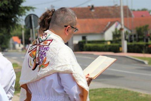 corpus christi feast  priest reading  procession