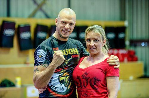 couple fighting stance fist raised