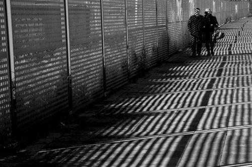 couple shadows street