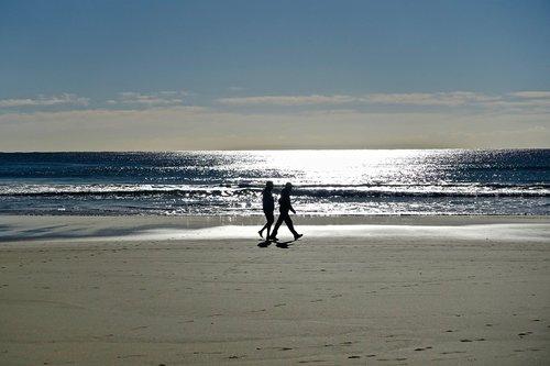 couple  stroll  beach