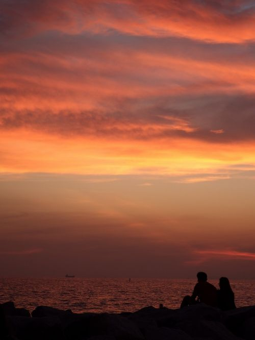 Couple Sit And Watch The Sunset