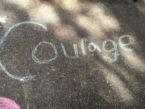 courage chalk hand