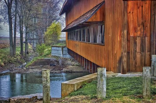 covered bridge scenery trees